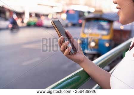 Diverse Asian Hipster Girl Using Mobile Cell Phone In Downtown Urban City Street - Millennial Influe
