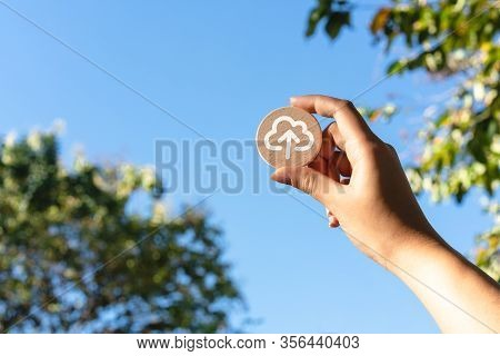 Diverse Asian Female Hand Holding Up Wood Disc With Cloud Computing Upload Icon - Cloud Computer Fil