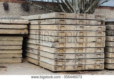 Pile Of Concrete Floor Slabs. Used Concrete Slabs Are Stacked On Top Of Each Other. Old Plates Stack