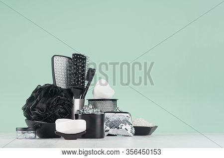 Fashion Bathroom Interior In Green Color With Black Accessories - Bath Sponge, Soap, Comb, Essential