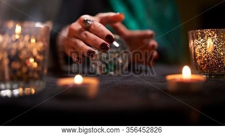 Fortuneteller female's hands with predictions ball