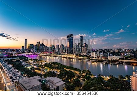 BRISBANE, AUSTRALIA - July 20 2019: Night time areal image of Brisbane CBD and South Bank. Brisbane is the capital of QLD and the third largest city in Australia