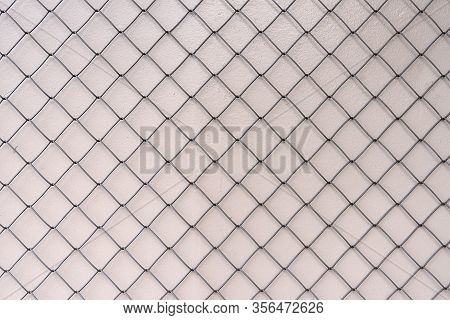 Mesh Netting On A Light Background. The Texture Of The Mesh Netting. Mesh Background