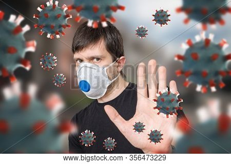 Man Is Protecting With Ffp3 Respirator Face Mask. Many Viruses Around.