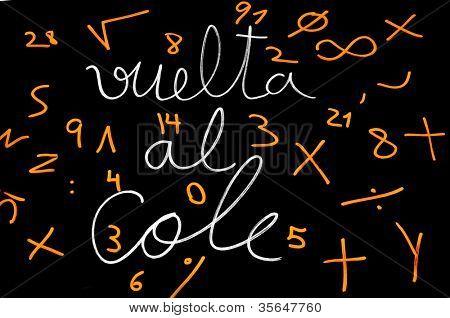 sentence back to school written in spanish, vuelta al cole, on a blackboard