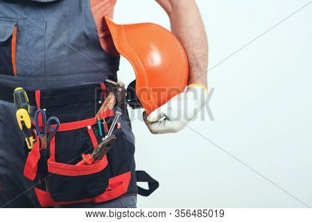 Professional Builder With Tools. Handyman With A Tool Belt. House Renovation Service. Construction W
