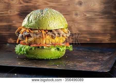 Veggie Burger. Lettuce, The Cutlet Vegetarian Meat Alternatives. Fried Onions And Carrots. Mushrooms