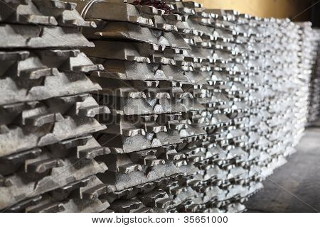 Stack of raw aluminum ingots in aluminium factory poster