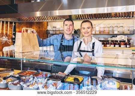 Small Business And To Go Service Concept Due To Isolation Emergency With Young Restaurant Owners Wor
