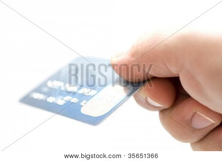 Hand holding credit cards. Small DOF