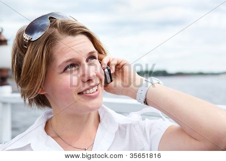 Attractive Woman In White Shirt With Sunglasses Calling On Mobile Telephone. Close Up