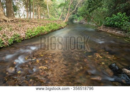 Beautiful Water Stream In The Forest Morning Scene , Thailand