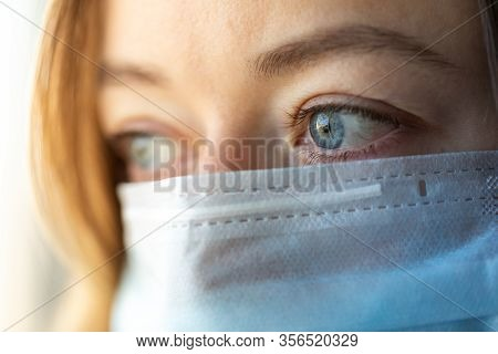 Woman Wearing Medical Mask. Woman With A Blue Medical Mask. Protective Medical Mask. Health Care And