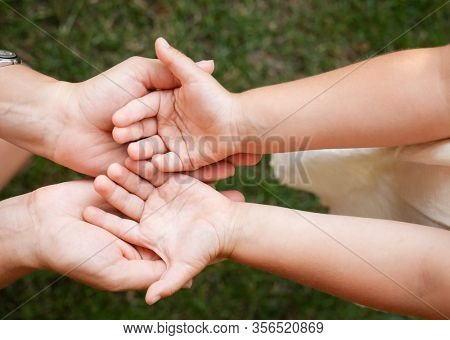 Top view of little girl showing her clean hands with palms up to mother after washing - basic protective measures against spreading of coronavirus epidemy concept