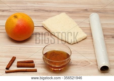 Ingredients For Homemade Anti Cellulite Wrap. Cellulite Treatment From Honey, Cinnamon And Grapefrui