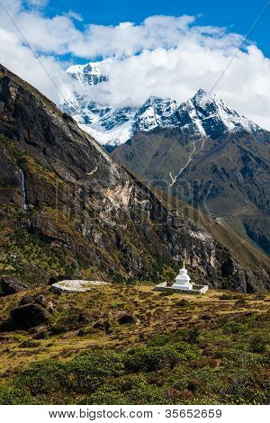 Buddhist Stupe Or Chorten And Summits In Himalayas