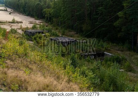 Mine Station Of The 1st And 2nd World War, Disguised By A Forest On The Shore Of The Gulf Of Finland
