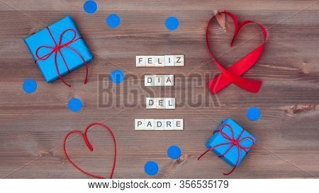 Feliz Dia Del Padre Words Made Of Wooden Blocks With Blue Gift Boxes And Red Hearts On Wooden Backgr
