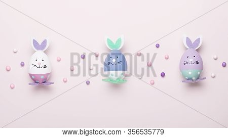 Funny Kawaii Cute Bunny Eggs In Pastel Colors On Pink Table Top, Easter Holiday Concept. Easter Deco