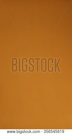 Ocher Background. A Dist Of Bright Colored Paper. Can Use As Background.