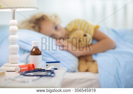 Sick Little Boy With Asthma Medicine. Ill Child Lying In Bed.