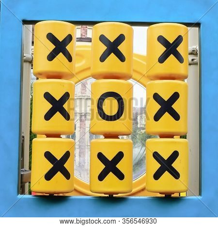 Tic Tac Toe Absurd Winning Combination Diagonally.capitulation. Yellow Plastic Details With X And O