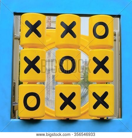 Tic Tac Toe Winning Combination Diagonally. Yellow Plastic Details With X And O Symbols Closeup Of M