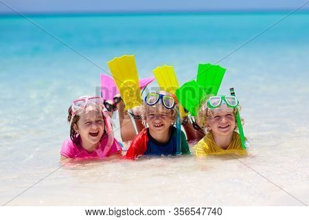 Kids Snorkel. Beach Fun. Children Snorkeling In Tropical Sea On Family Vacation On Exotic Island
