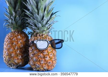 Pineapple In Sunglasses Close-up On Blue Background
