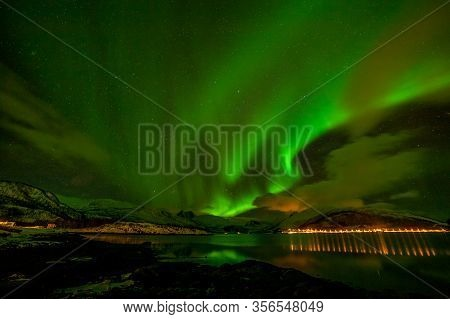 Aurora Borealis In Tromso, Norway In Front Of The Norwegian Fjord, Winter Season, Long Shutter Speed