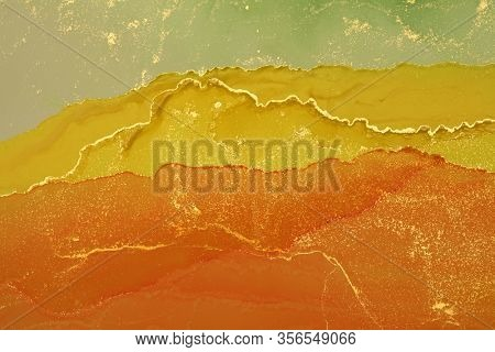 Abstract yellow wave blots horizontal background. Alcohol ink colors. Marble texture.