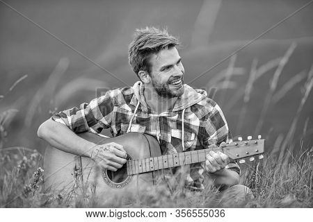 Hiking Song. Man Musician With Guitar On Top Mountain. Inspired Musician. Summer Music Festival Outd