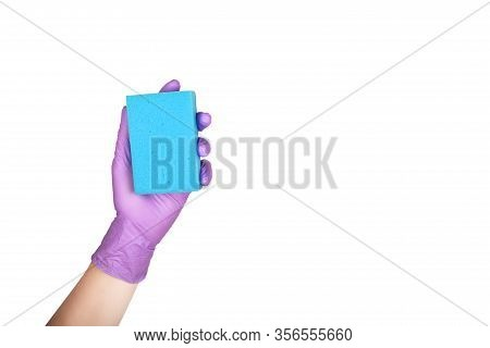 Hand In A Glove Holds A Sponge For Washing And Cleaning Dishes