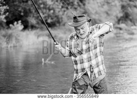 Fisherman Fishing Equipment. Fisherman Alone Stand In River Water. Hobby Sport Activity. Fish Farmin