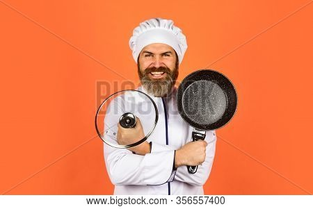 Enjoying Cooking. Chef Holds Kitchenware. Happy Cook Man Hold Frying Pan. Chef In Uniform Cooking So