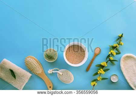 Natural Cosmetics, Soap, Himalayan Salt, Cosmetic Mittens, Pumice Stone, Comb, Towel On A Blue Table
