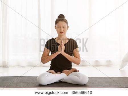 Middle Aged Women Practicing Yoga In Lotus Pose Or Padmasana With Raised Hands Namaste. Meditation W