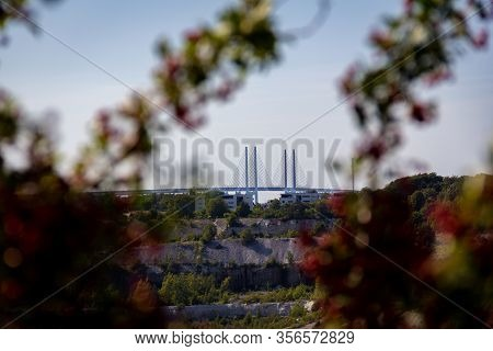 The Oresund Bridge Is Rising Above The Horizon. Seen From The Old Limestone Quarry, A Deep Hole In T