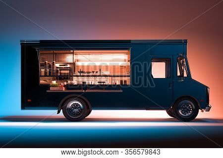 Side View Of Black Food Truck With Detailed Interior Isolated On Illuminated Background. Takeaway Fo