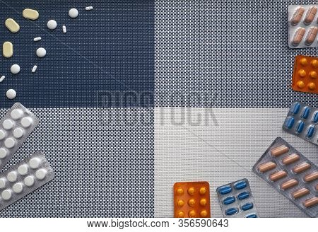 Background With Medical Supplies And Place For Text. On The Right, The Tablets In The Blisters Are I