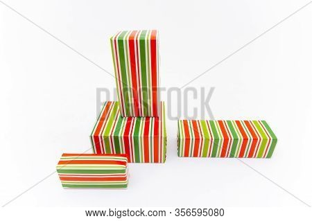 Shopping In Colorful Packaging. Boxes With Xmas Presents Wrapped. Isolated On White Background