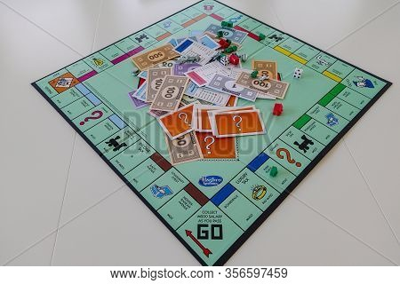 Orlando, Fl/usa-12/20/19:  Pieces For The Game Monopoly By Hasbro On A White Background.  Concept Bu
