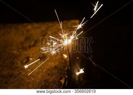 Burning Sparking Stick Starlight Fireworks Pyrotechnic Dark Black Warm Background