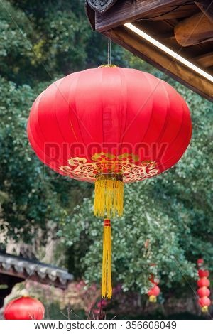 Beautiful red Chinese lantern hanging on eaves of  traditional Chinese old style wood  building to decorated the Chinese festive holiday in a park,Three lanes and seven alleys,Fuzhou,Fujian,China