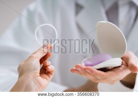 Gynecologist Showing Contraception Ring To Woman And Explaining Contraception And Birth Control Meth