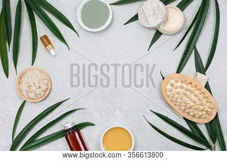 Spa Product Composition And Natural Cosmetic With Palm Leaves And Massage Brush