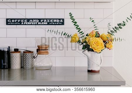 Yellow Large Roses And Eucalyptus Branches In The Ceramic Craft White Vase. Kitchen Counter Top. Lif