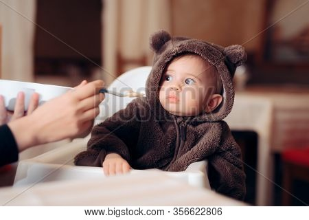 Funny Baby Sitting In Highchair Refusing To Eat