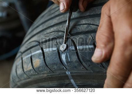 Solve Problem Wheel In Garage Auto Repair Shop Service. Replacement Repairman Fixing Car's Tire Tryi