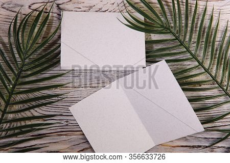 Mosk Up. Abstract Background. Two Cards Of Different Sizes On A Wooden Surface. Texture Of Paper And